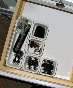 Use small plastic bins and organizers to keep small items from escaping.