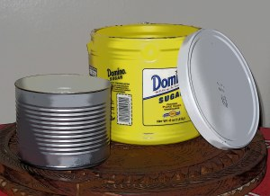 Use cans or plastic tubs for homemade rattles or drums.  Fill with dried beans and dried prosperity herbs.