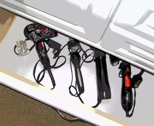 A drawer for hair care items arranged so that I can grab the dryer or iron I need quickly.