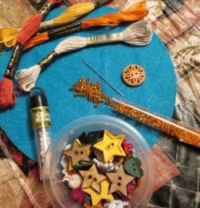 """For this bundle, I did not choose an inside lining as I wanted to keep the bundle from being to bulky.  I then choose what beads or embellishments that I felt lent themselves to the theme.  Orange is an odd color; but, it felt right.  In making healing items I've learned to """"go with your gut""""."""