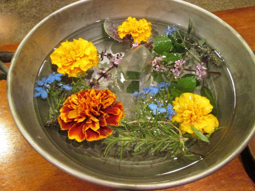Water Offering with fresh herbs and flowers from the hearthstone.